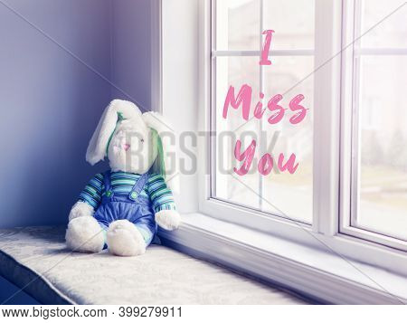 I Miss You Card With Pink Letters Words Text. Cute Adorable Lonely Stuffed Toy Bunny Sitting On Wind