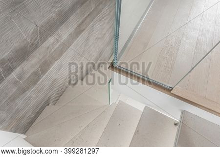 Grey Microcement Stairs With Glass Handrail. Stairs Viewed From Above. Modern Design And Innovative
