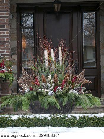 Winter Bouquet As Christmas Decoration Near The Door