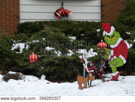 Figurines In Front Yard As Christmas Decoration