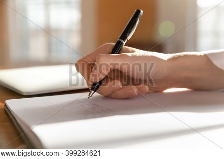 Close Up Of Female Doctor Make Notes In Medical Journal