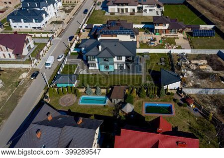 Aerial View Of Houses On Ukraine Housing Estates, Some With Building On Roof Panels