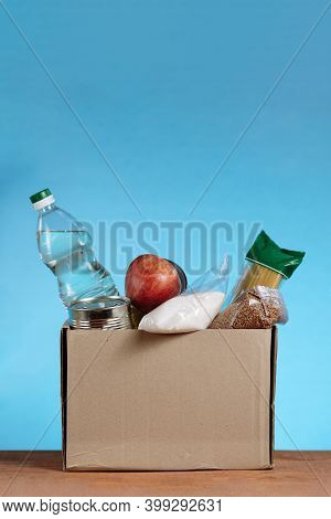 Donation Box With Food Isolated On White Background. Close Up Of Different Food In A Volunteer Box.