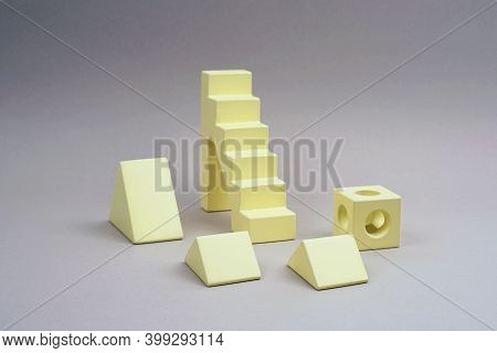Childrens Wooden Construction Kit. Figures From A Yellow Wooden Construction Kit. Popular Color 2021