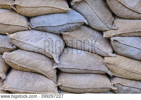 Texture Lying On Each Other Old Sandbags. Piled Sandbags For Protection Against Natural Disasters, B