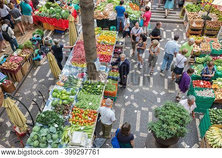 Funchal At Madeira, Portugal - August 01, 2014: Vendors Selling Fresh Vegetables At Famous Market Me