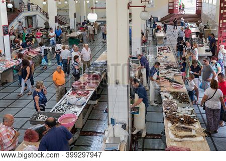 Funchal At Madeira, Portugal - August 01, 2014: Butchers Saling Fish At The Fish Market Of The Famou