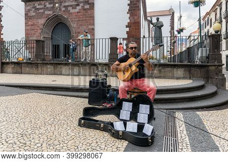Funchal At Madeira, Portugal - August 01, 2014: Busker Playing Guitar Downtown Funchal At Madeira Is