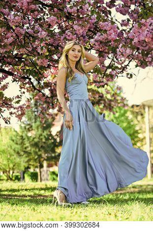 Femininity. Sakura Season. Sakura Tree Blooming. Pretty Blonde Fancy Woman. Gorgeous Girl. Spring Fa