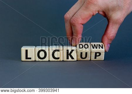 Lockdown Or Lockup Symbol. Hand Turns Cubes And Changes The Word 'lockup' To 'lockdown'. Beautiful G