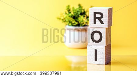 Roi - Acronym From Wooden Blocks With Letters, Concept. Roi - Return On Investment