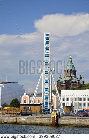 Helsinki, Finland. July, 24, 2014. Helsinki Harbour From Waterside Ferris Wheel Uspenski Cathedral