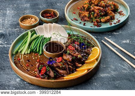 Peking Duck Marinated In Classic Chinese Recipe, Fried Fillet Served With Specialty Sauces Hoisin An