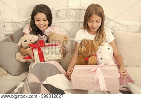 Birthday Surprise. Surprised Kids. Birthday Girls. Happy Children Receive Birthday Gifts In Bed. Enj