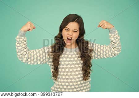 Girl Power. Little Girl Flex Arms Blue Background. Small Girl With Long Hair Show Strength. Fit And