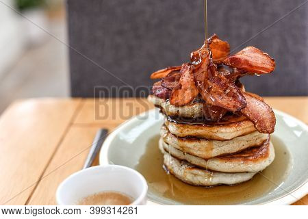 Pancake Stack With Maple Syrup And A Large Portion Of Bacon As A Breakfast Or Brunch Meal