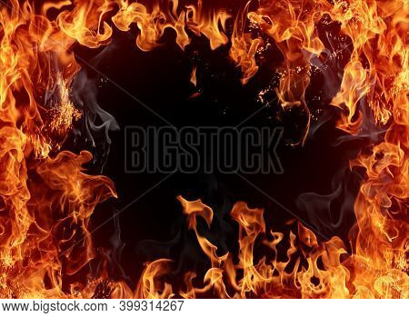 Burning frame. Texture of real fire flames and sparks isolated on black background