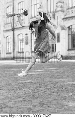 Always Energetic. Happy Girl In Energetic Jump Outdoors. Energetic Mood. Fresh Vibes. Music And Ente