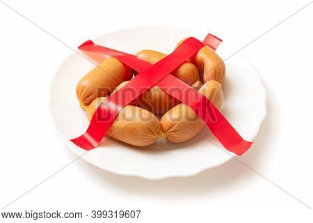 Refusal, Prohibition To Eat Sausages, Sausage. Crossed-out Sausages On A Plate On A White Background