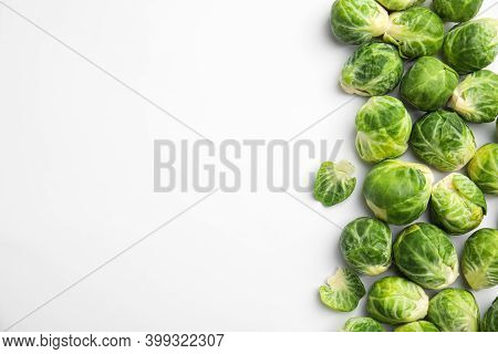 Fresh Brussels Sprouts On White Background, Top View. Space For Text
