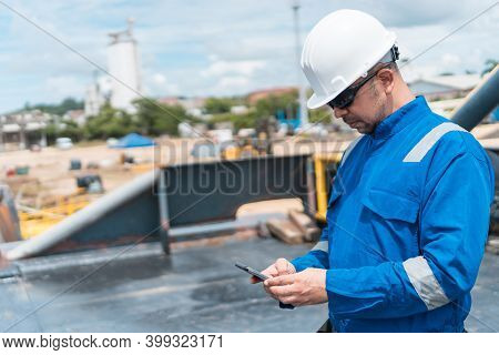 Officer Of The Deck In The Maritime Ship Deck, With Cell Phone
