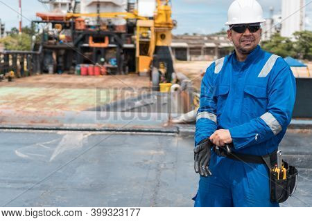 Marine Deck Officer Or Chief Mate On Deck Of Offshore Vessel Or Ship, Wearing Ppe Personal Protectiv