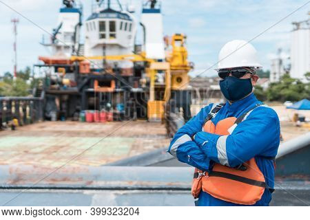 Deck Officer With Protective Mask On Ship Deck, With Ppe Personal Protective Equipment