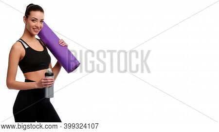 Caucasian Strong Woman With Mat And Bottle Of Water On White Isolated Background. Fitness Instructor