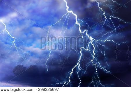 Lightnings In Dark Cloudy Sky During Thunderstorm