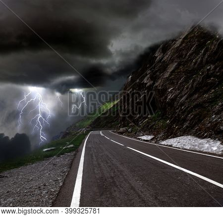 Dark Cloudy Sky With Lightnings. Picturesque Thunderstorm In Mountains