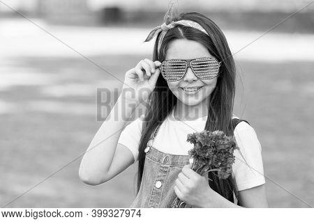 Wishing Happy Anniversary. Happy Kid Hold Flowers Outdoors. Fashion Look Of Little Girl. Cornflower