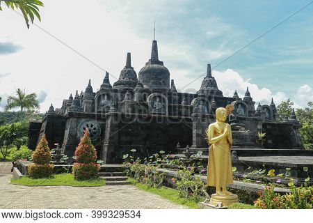 Statue Of The Buddhist God Buddha In The Buddhist Temple Brahma Vihara Arama With Statues Of The God