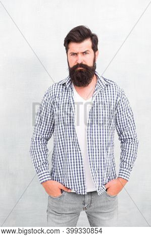 Self Confidence. Well Groomed Guy. Brutal Handsome Hipster Man Grey Wall Background. Bearded Man Tre