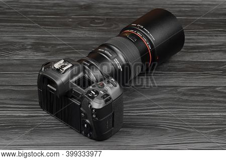 Canon Eos R Photocamera And Mount Adapter Ef - Eos R With Canon 105mm F2.8 Lens On Black Wooden Tabl