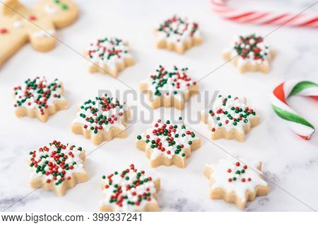 Christmas Butter Snowflake Icing Cookies With Sprinkles Decoration