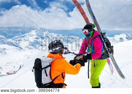 A Man Athlete Skier Freerider Makes A Proposal To Marry His Woman Skier High In The Mountains In Win