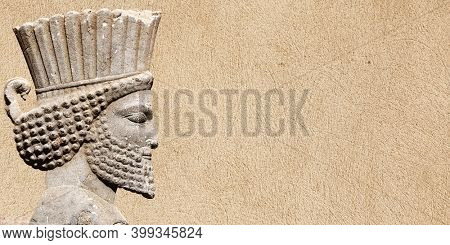 Ancient wall with bas-relief with assyrian warriors, Persepolis, Iran. UNESCO world heritage site. Horizontal background with embossed image persian bearded man. Mock up template. Copy space for text