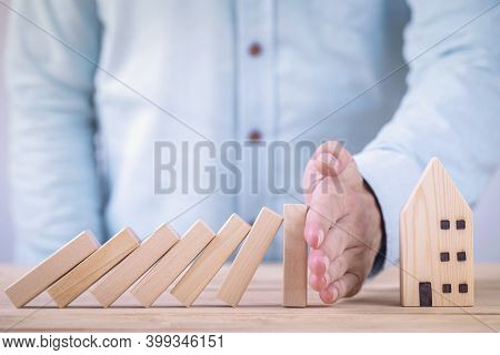 Business Hands Stop Wooden Blocks Of Domino Effect Before Destroy House , Private Property Protectio