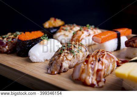 Japanese Sushi Set , Sushi Nigiri Rolls And Sashimi Served In Japanese Food Restaurant Menu