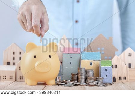 Businessman Save Money On Piggy Bank , Planning For The Future Of Rent For An Apartment Or Home Conc