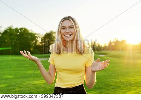Gesturing Young Beautiful Female Teenager Talking At Camera, Student 16, 17 Years Old Giving Intervi