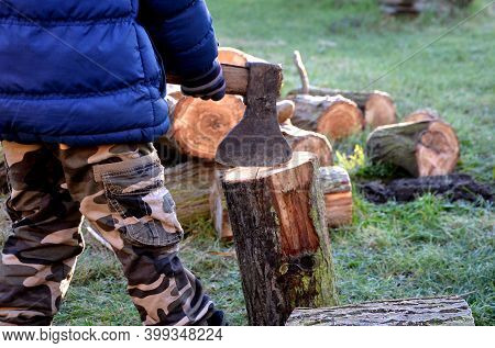 Camping Skills Father With Son. Chopping Wood Log From Willow In Autumn. The Father Shows With An Ax