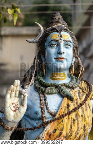 Statue Shiva, Hindu Idol On The Ghat Near The Ganges River In Rishikesh, India, Close Up