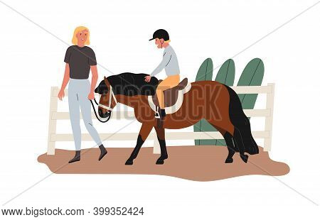 Child Riding Pony At Racecourse. Instructor Teaching Kid At Equestrian School. Lesson Of Horseriding