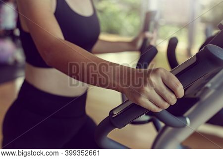Close-up Sportwoman Walking Or Running On Treadmill Equipment In Fitness Workout Gym.concept Fitness