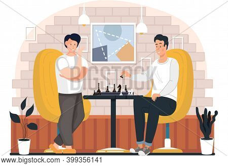 A Group Of People Is Playing Chess At Home. Young Guys Communicate And Spend Time Together. A Man Ho