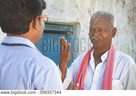 Shoulder Shot, Angry Indian Farmer Shouting At Banker Or Corporate Officer Due To Farm Loan Subsidy