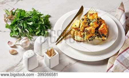 Strata Or Italian Breakfast Casserole Of Spinach, Cheese And Soaked Overnight Cubed Bread Baked With