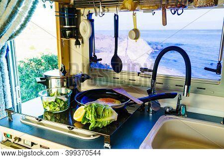 Caravan Rv Inside, Kitchen Area. Cooking Dinner Meal In Campervan. Holidays, Adventure With Motor Ho