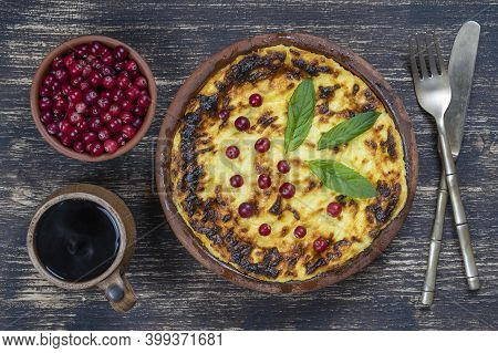 Sweet Cottage Cheese Casserole With Raisins And Semolina On Wooden Table. Ceramic Bowl With Baked Co